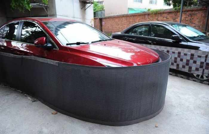 Chinese Drivers Covering Their Cars with Rat-Proof Cover -03