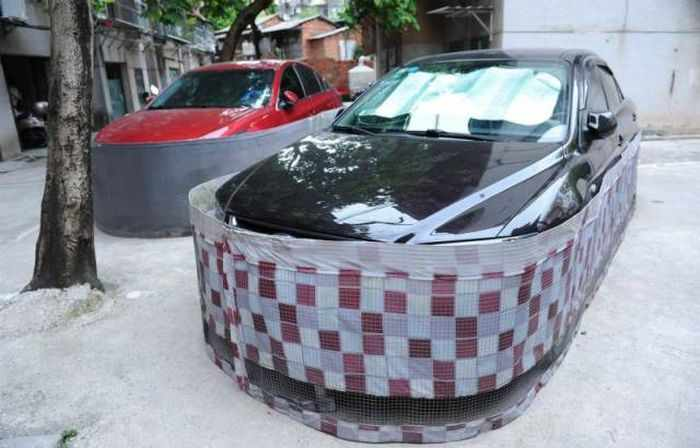 Chinese Drivers Covering Their Cars with Rat-Proof Cover -05