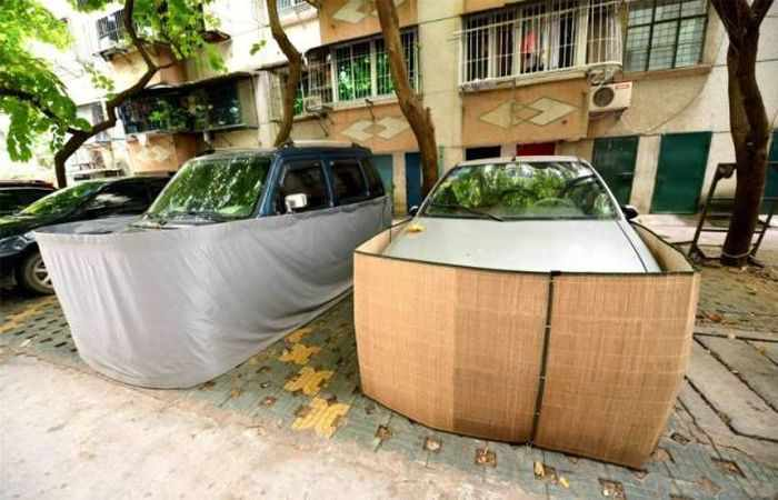 Chinese Drivers Covering Their Cars with Rat-Proof Cover -08