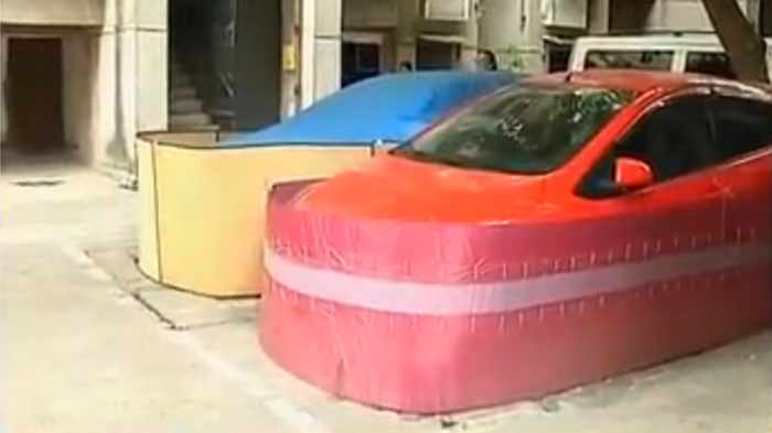 Chinese Drivers Covering Their Cars with Rat-Proof Cover -09
